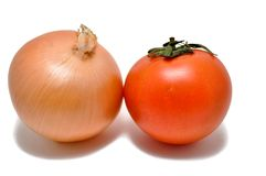 Onion and Tomato. Fresh Onion and Tomato side by side against a white isolated background royalty free stock photography