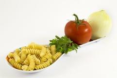 Onion, tomato, parsley and pasta. On white background Stock Photos
