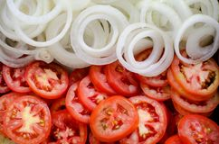Onion and tomato slice. Background Stock Image