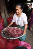 Onion. Traders sort of onion in a market in the city of Solo, Central Java, Indonesia Stock Photos