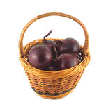 Onion turnip in brown wicker basket isolated Stock Image