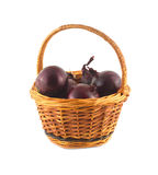 Onion turnip in brown wicker basket isolated Royalty Free Stock Photography