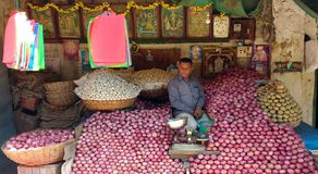 Onion vendor on market Royalty Free Stock Image
