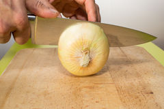 Onion vs knife Stock Photo