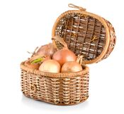 Onion in a wooden basket. Raw onion in a wooden basket isolated on a white background stock photography