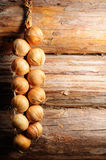 Onion on Wooden Wall with Copy Space Stock Photography