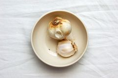 Onions. Two onions sitting in a bowl Stock Images