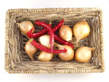 Onions. And chilli peppers in a basket Royalty Free Stock Photo