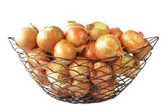 Onions. Many big onions in a decoratively wire basket Stock Images