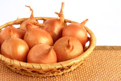 Onions. On a wicker background Stock Images