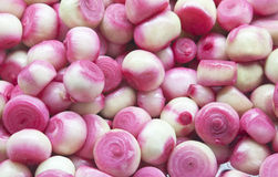 Onions. Colorful raw onions pile closeup Stock Photos