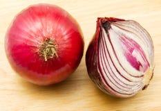 Onions. Purple onions on the wood stock photos