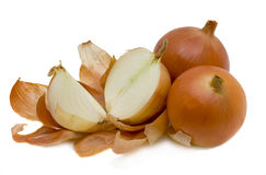 Onions. Three large golden onions isolated on the white Royalty Free Stock Photos