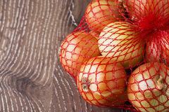 Onions in a bag Royalty Free Stock Photos
