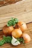 Onions and basil leaves. On bamboo mat Stock Photo