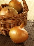 Onions in a basket Royalty Free Stock Photography