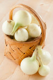Onions in basket Stock Photo