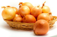 Onions in a basket Royalty Free Stock Images
