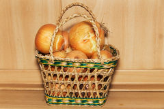 Onions in the basket Stock Photography