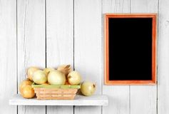 Onions in a basket Royalty Free Stock Photo