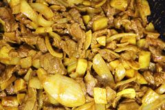 Onions and Beef Casserole. For dinner or tea this evening. Served with rice and perhaps some boiled potatoes it makes a delicious and appetising dinner stock images