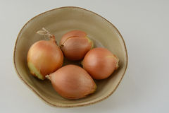 Onions in bowl Stock Photos