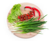 Onions and cherry tomatoes Royalty Free Stock Photography