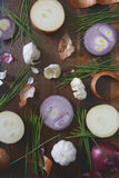 Onions, chives and garlic scattered on wood table Royalty Free Stock Image