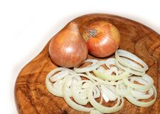 Onions on cutting board Royalty Free Stock Image
