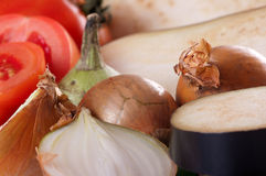 Onions, eggplant and tomatoes. Ingredients such as meal onions, eggplant and tomatoes Royalty Free Stock Image