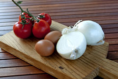 Onions, eggs and tomatoes Stock Image