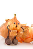 Onions with funny doll Stock Images