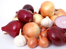 Onions and garlic. Isolated on white, macro with copy-space, copy space Royalty Free Stock Image