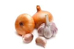 Onions and garlic. Two onions and a garlic on a white background closeup Royalty Free Stock Photo