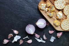 Onions and garlic with blue stilton and Shropshire cheese Royalty Free Stock Images