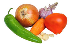 Onions, garlic, carrots, tomato, burning pepper isolated on a white background Royalty Free Stock Photos