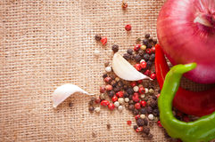 Onions, garlic, chili pepper and spices on the table, top view Royalty Free Stock Images