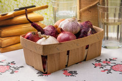 Onions and Garlic in a Crate Stock Photography