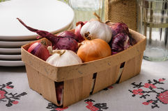 Onions and Garlic in a Crate Royalty Free Stock Photography