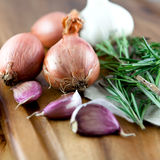Onions,garlic and fresh rosemary Royalty Free Stock Images