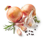 Onions, garlic and spices. Isolated on white background Royalty Free Stock Photography