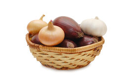 Onions and garlic in a wattled basket Royalty Free Stock Photography