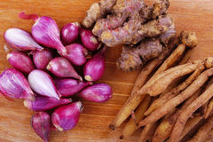 Onions and Ginger. Ginger and Red Onions on wooden cutting board for food ingredients royalty free stock photography