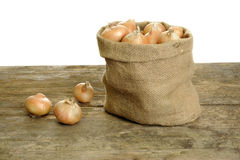 Onions in a jute bag Royalty Free Stock Image