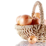 Onions napiform in a basket Stock Photos