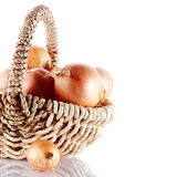 Onions napiform in a basket Royalty Free Stock Photography