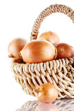 Onions napiform in a wattled basket Stock Photography