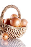 Onions napiform in a wattled basket Royalty Free Stock Photos