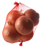 Onions in net. Against a white background Stock Photo