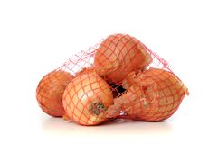 Onions in a net isolated on white Royalty Free Stock Photo